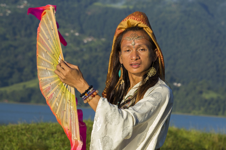 shemale: Shemale Sirena Sabiha dancing with a fan at sunrise in Pokhara, Nepal. Sirena was born in the Philippines. Close up
