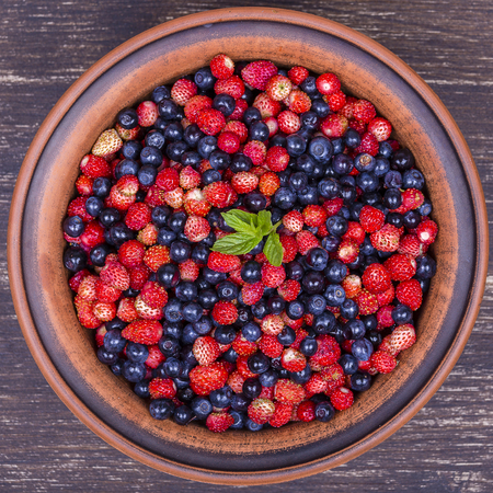 background textures: Fresh strawberries and blueberries , wild berry. Close up