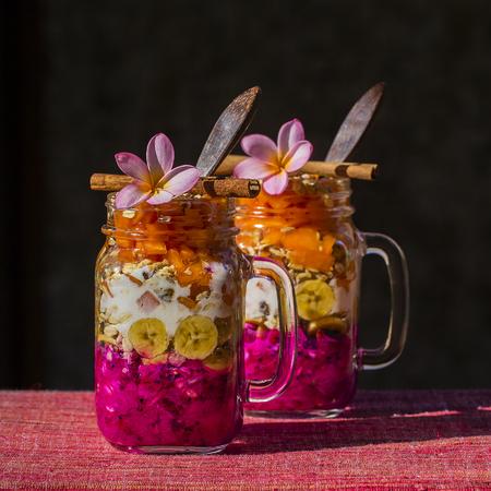 ubud: Muesli made from papaya, avocado, dragon fruit, banana and dressed with yogurt. Island Bali, Ubud, Indonesia Stock Photo
