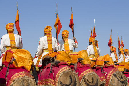 JAISALMER, INDIA - FEBRUARY 08, 2017 : Camel and indian men wearing traditional Rajasthani dress participate in Mr. Desert contest as part of Desert Festival in Jaisalmer, Rajasthan, India