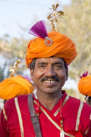 JAISALMER, INDIA - FEBRUARY 08, 2017 : Unidentified men wearing traditional Rajasthani dress participate in Mr. Desert contest as part of Desert Festival in Jaisalmer, Rajasthan, India. Close up