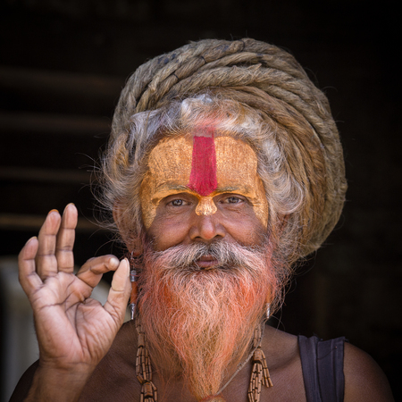 KATHMANDU, NEPAL - SEPTEMBER 25, 2016 : Portrait Sadhu at Pashupatinath Temple in Nepal. Sadhu is a holy man, who have chosen to live an ascetic life and focus on the spiritual practice of Hinduism. Stock Photo - 89157485
