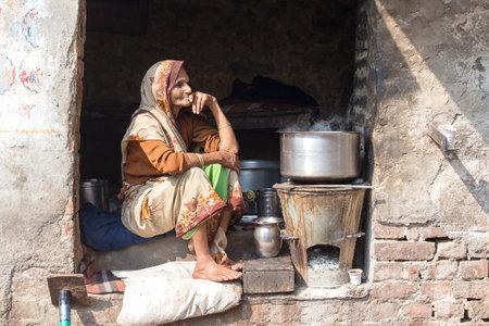 VARANASI, INDIA - JANUARY 25, 2017 : Portrait old beggar woman on street at Dashashwamedh Ghat in Varanasi, Uttar Pradesh, India