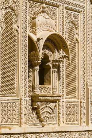 Indian ornament on wall of palace in Jaisalmer fort, India. Close up
