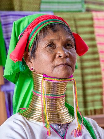 INLE LAKE, MYANMAR - JANUARY 14 2016: Padaung Tribal woman poses for a photo in Inle lake, Myanmar, Burma The Padaung-Karen long-necked tribe women are minority of Myanmar.