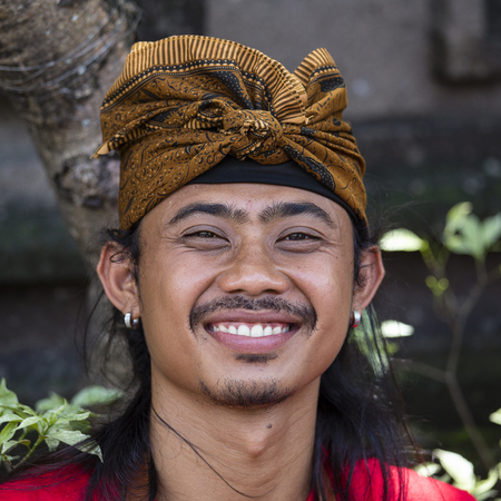GIANYAR, BALI, INDONESIA - JANUARY 08, 2018 : Unknown Balinese man participates in a street ceremony, during a pre-election rally, the Indonesian Democratic Party of Struggle in island Bali, Indonesia Editorial