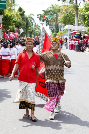 GIANYAR, BALI, INDONESIA - JANUARY 08, 2018 :Unknown Balinese old man participates in street ceremony, during a pre-election rally the Indonesian Democratic Party of Struggle in island Bali, Indonesia