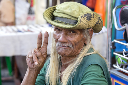 BANGKOK, THAILAND - JANUARY 21, 2015: Unidentified man living in a poor district of Bangkok Klong Toe. Khlong Toei is one of Bangkoks poorest areas