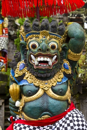 A traditional Balinese statue of Barong on a street temple in Bali, Indonesia. Close up