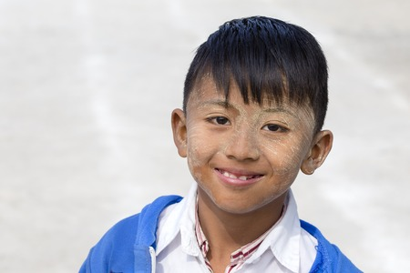 INLE LAKE, MYANMAR - JANUARY 11, 2016: Unidentified young boy with thanaka on face in local school Editorial