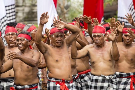 GIANYAR, BALI, INDONESIA - JANUARY 08, 2018 :Unknown Balinese old men participates in street ceremony, during a pre-election rally the Indonesian Democratic Party of Struggle in island Bali, Indonesia