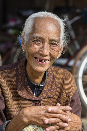 INLE LAKE, MYANMAR - JANUARY 13, 2016: Unidentified old woman in market. The local people are hospitable and friendly to tourist in Burma, Myanmar Editorial