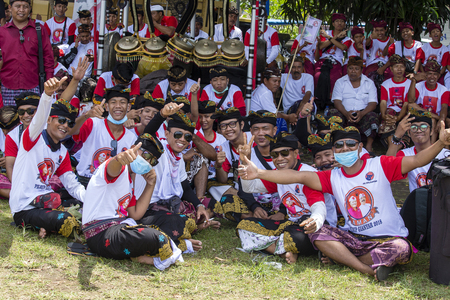 GIANYAR, INDONESIA - JANUARY 08, 2018 : Unknown Balinese young guys participates in street ceremony, during a pre-election rally, the Indonesian Democratic Party of Struggle in island Bali, Indonesia Editorial