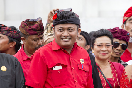 GIANYAR, BALI, INDONESIA - JANUARY 08, 2018 : Agus Mahayastra leads a Indonesian Democratic Party of Struggle, PDI-P, at the pre-election meeting in Gianyar, island Bali, Indonesia