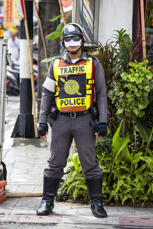 PHUKET, THAILAND - OCT 16, 2015 : Unknown thai policman during a street procession in Vegetarian Festival at Phuket Town, Thailand Editorial