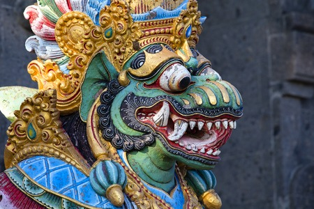 Traditional Balinese statue of Barong on a street temple in Bali, Indonesia. Close up