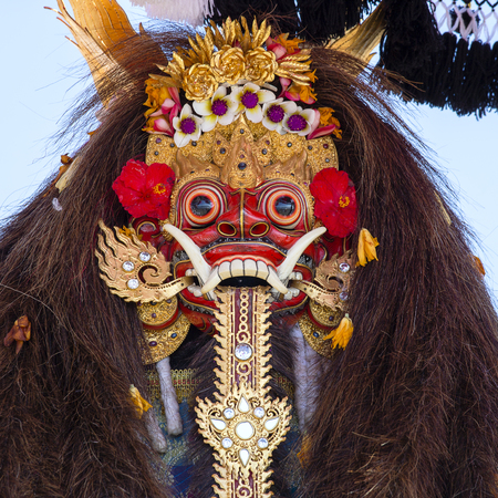 Traditional Balinese Barong mask on street ceremony in island Bali, Indonesia. Close up