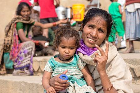 VARANASI, INDIA - JANUARY 26, 2017 : Portrait mother and children on the street at the ghats of Varanasi, Uttar Pradesh, India