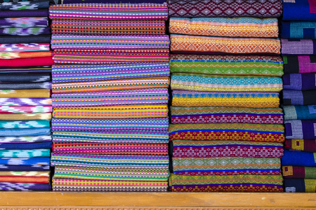 Assortment of colorful sarongs for sale in local market, Yangon, Myanmar, Burma. Close up
