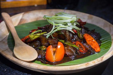 Indonesian dish from Jakarta - Oseng Kikil Mercon Kecap, dish from stir-fried cowhide, close up