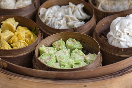 Fresh dim sum in bamboo steamer, chinese cuisine for sale at a local market in Ubud, Bali, Indonesia. Close up