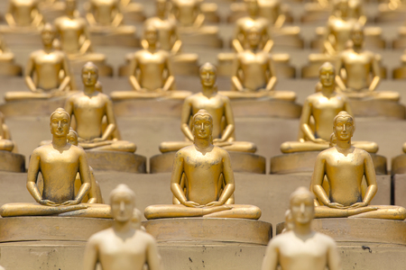 Million golden Buddha figurine in Wat Phra Dhammakaya. Buddhist temple in Bangkok, Thailand. Close up