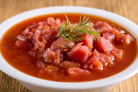 Vegetable soup - red borsch, close up. Healthy beetroot soup, vegetarian food. Ukrainian and russian national food - red beet soup, borscht.