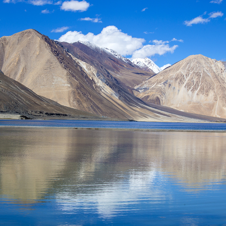 Himalayas Mountains with Pangong tso lake and blue sky with white clouds, Leh, Ladakh, Jammu and Kashmir, India