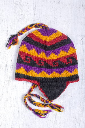 Colorful handmade knitted hats on the Nepalese market, close up