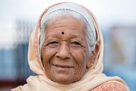 KATHMANDU, NEPAL - OCTOBER 05, 2016 : Portrait old women in traditional dress in street Kathmandu, Nepal Editorial