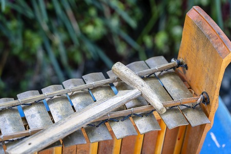 Traditional Balinese musical percussion instrument - xylophone Jegog with hammer, part of orchestra Gamelan. Arts, Music and culture of Bali and Indonesian people and asian travel backgrounds, close up