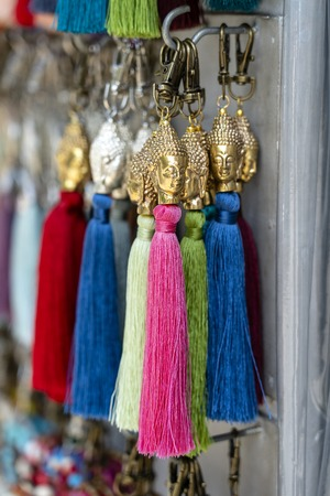 Thread earrings for sale on local street market in Ubud, island Bali, Indonesia, close up
