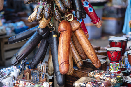 Wooden penises figures souvenir on display for sale to tourists on street local market in Ubud, island Bali, Indonesia. Wooden penises are used in Bali as a remedy against the evil eye and bad spirits Stock Photo - 120865625