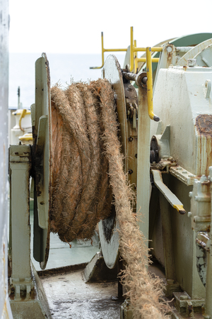 A thick rope is wrapped around a drum on deck of a ferry boat , Thailand. Close up Reklamní fotografie