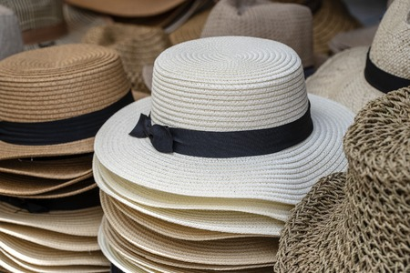 Straw hats on display for sale to tourists on street local market in Ubud, island Bali, Indonesia, close up Reklamní fotografie