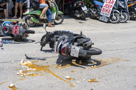 KOH PHANGAN, THAILAND - MAY 19, 2019 : Motorcycle accident that happened on the road at tropical island Koh Phangan, Thailand . Traffic accident between a motorcycle on street
