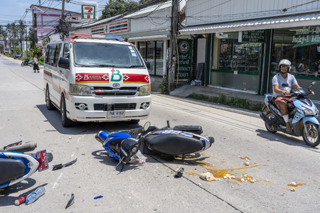 KOH PHANGAN, THAILAND - MAY 19, 2019 : Motorcycle accident that happened on the road at tropical island Koh Phangan, Thailand . Traffic accident between a motorcycle on street Stock Photo - 126073387