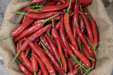 Red chili pepper for sell in traditional street market in Ubud, Bali, Indonesia , close up