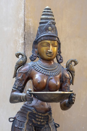 Detail of the bronze figure in the souvenir shop on street market in Jaipur, Rajasthan, India. Close up