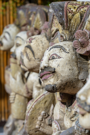 Traditional Balinese stone statue of the deity in the street temple. Island Bali, Indonesia. Close up Stock Photo