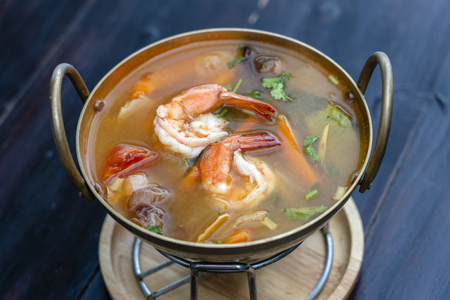 Tom yam kung or Tom yum, Tom yam is a spicy clear soup with shrimps, close up. Popular food in Thailand, thai cuisine Stock Photo - 124468901