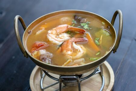 Tom yam kung or Tom yum, Tom yam is a spicy clear soup with shrimps, close up. Popular food in Thailand, thai cuisine Stock Photo