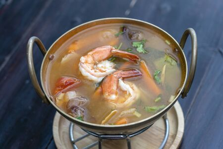 Tom yam kung or Tom yum, Tom yam is a spicy clear soup with shrimps, close up. Popular food in Thailand, thai cuisine Stock Photo - 124601854