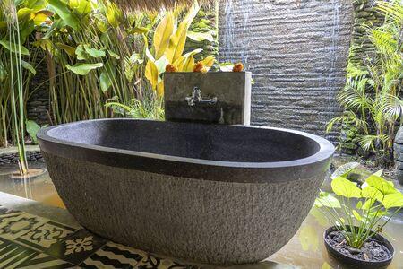 Romantic outdoor stone bathroom in tropical yard on island Bali, Indonesia
