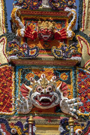 Bade cremation tower with traditional Balinese sculptures of demons and flowers on central street in Ubud, Island Bali, Indonesia. Prepared for an upcoming cremation ceremony. Close up Stock Photo