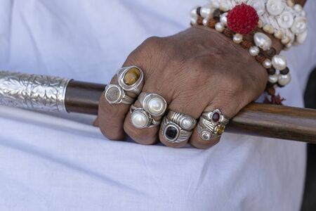 Beautiful male hand decorated with rings and bracelets in Pushkar, Rajasthan, India. Close up