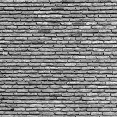 Background of old vintage brick wall texture, close up. Black and white
