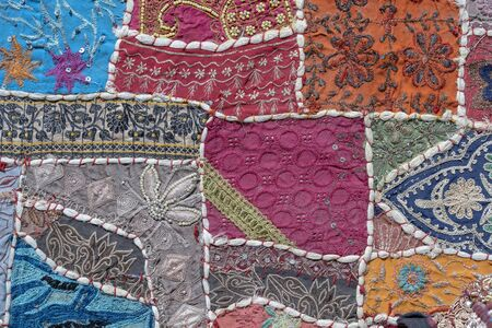 Detail old colorful patchwork carpet, India. Close up Stock Photo