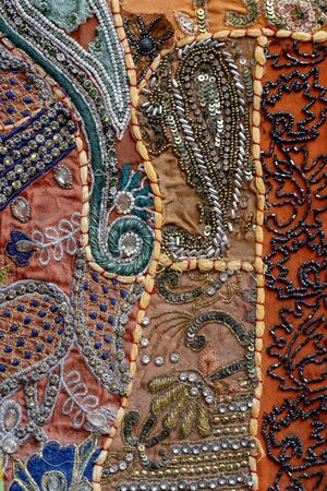 Detail old colorful patchwork carpet, India. Close up Imagens