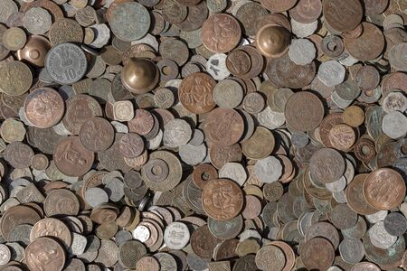 Old vintage fake coins background for sale to tourists in the Indian market on the street in Rishikesh, India. Close up, top view